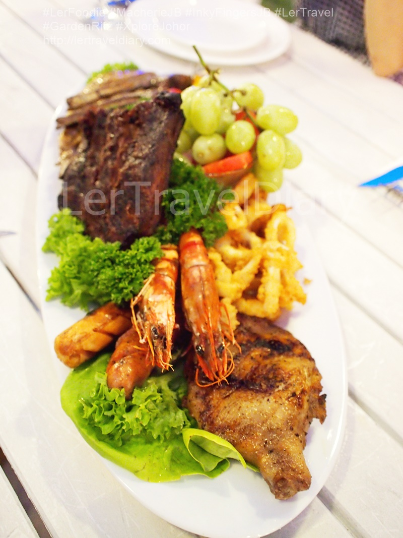Signature Meat Platter RM198.00. An array of meat foe meat lovers. Chicken, lamb, pork, beef rib, fried calamari, sausages ad curly fried. Salad, grapes and watermelon to balance off the taste.